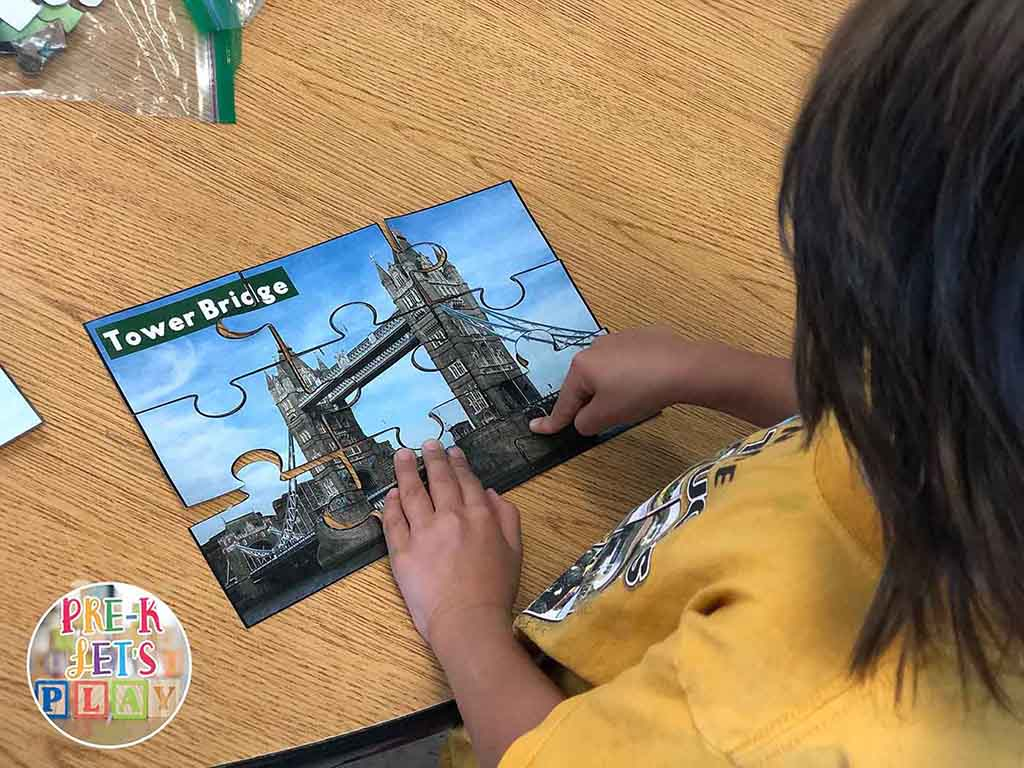 Student playing and completing a puzzle about bridges. Puzzle games for kids like this are great for building fine motor skills.