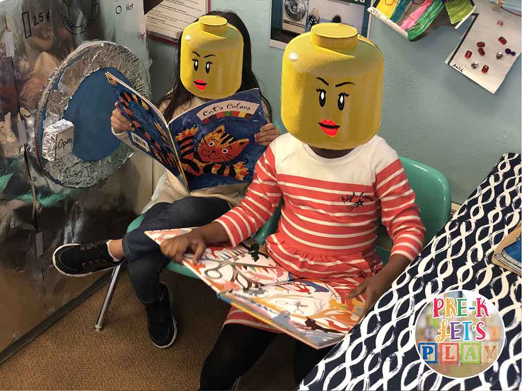 Students reading books in the dramatic play. In this dramatic play theme, they are waiting for their pretend clothes to finish washing.