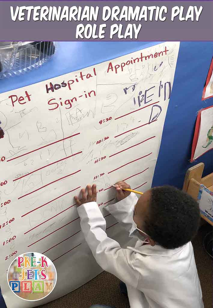 Kids practicing their names in the pet vet dramatic play hospital. They are pretending to schedule appointments for pretend play.