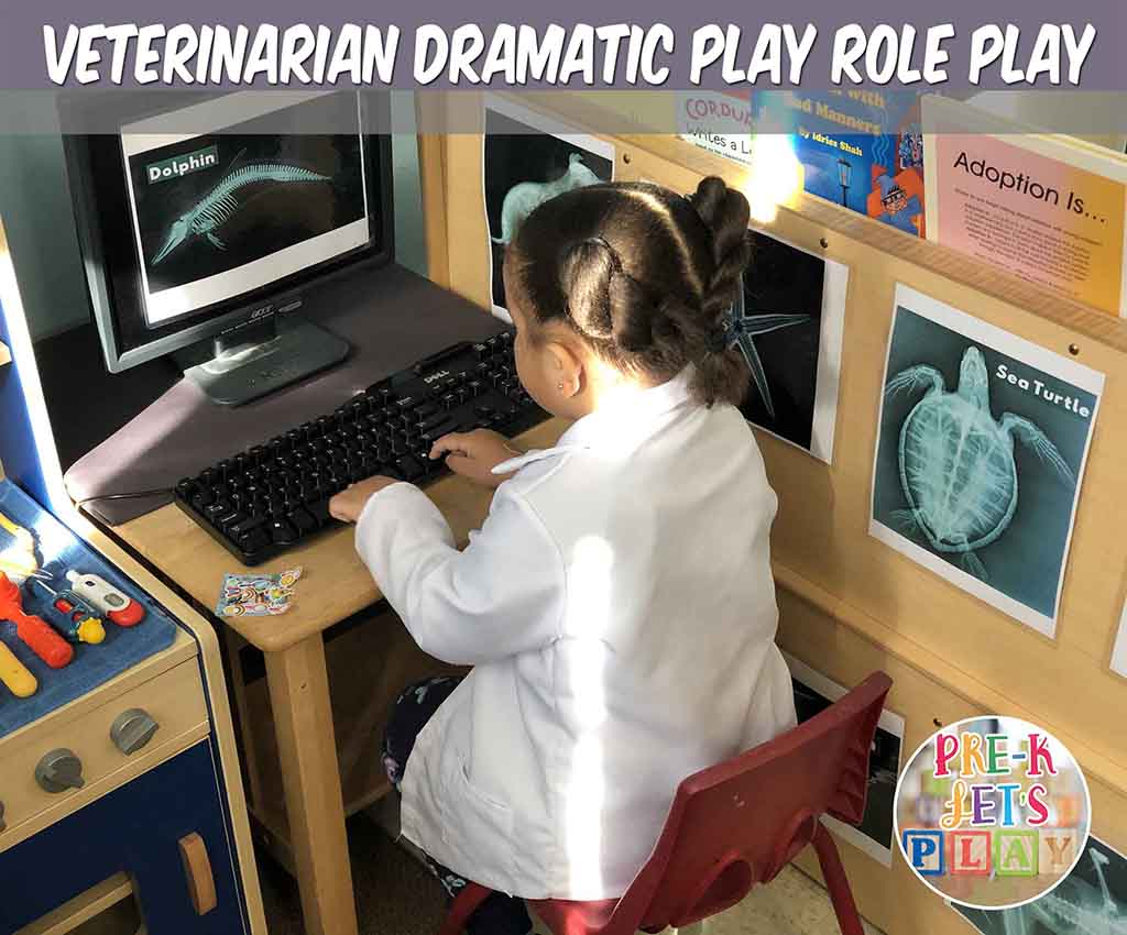 Student acting as a veterinarian for pretend play. She is looking at animal x-rays in the pet vet dramatic play clinic.