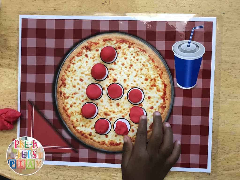 Pre-K Let's Play offers preschool playdough activities. This preschool activity is called number pizza. One of the many educational games we have to offer.