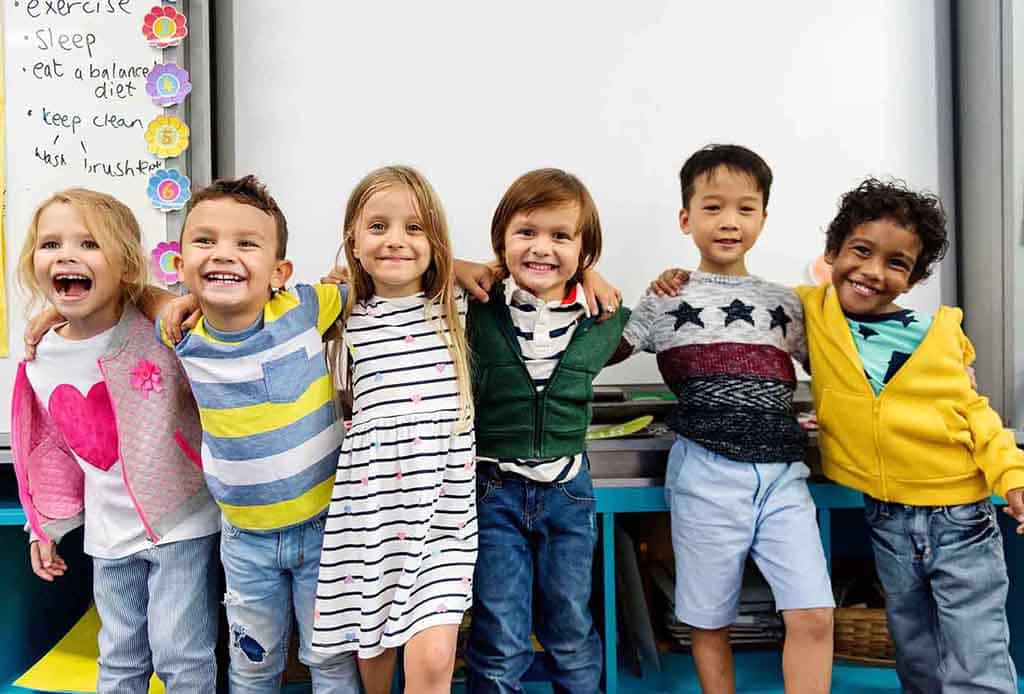 A group of happy kids together. They are ready to play and learn with with preschool activities made by Pre-K let's Play.