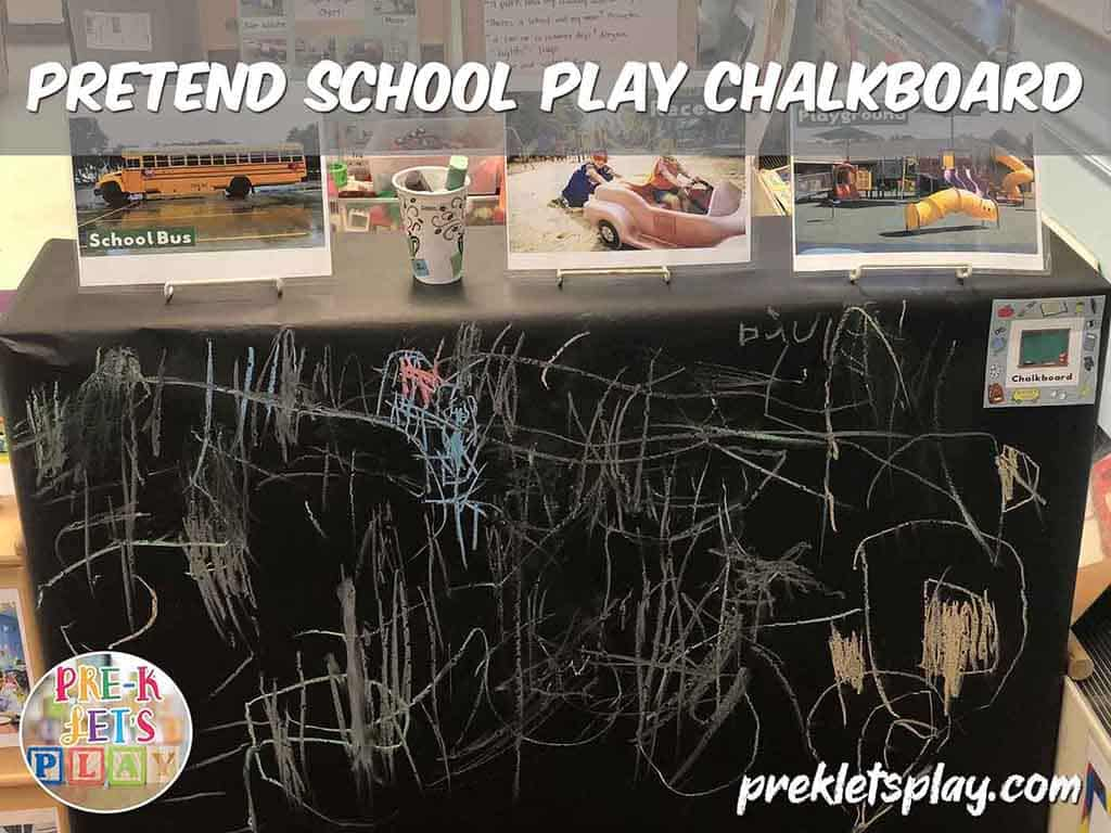 Hand made pretend school play chalkboard for dramatic play. Great to use for fine motor skills practice.