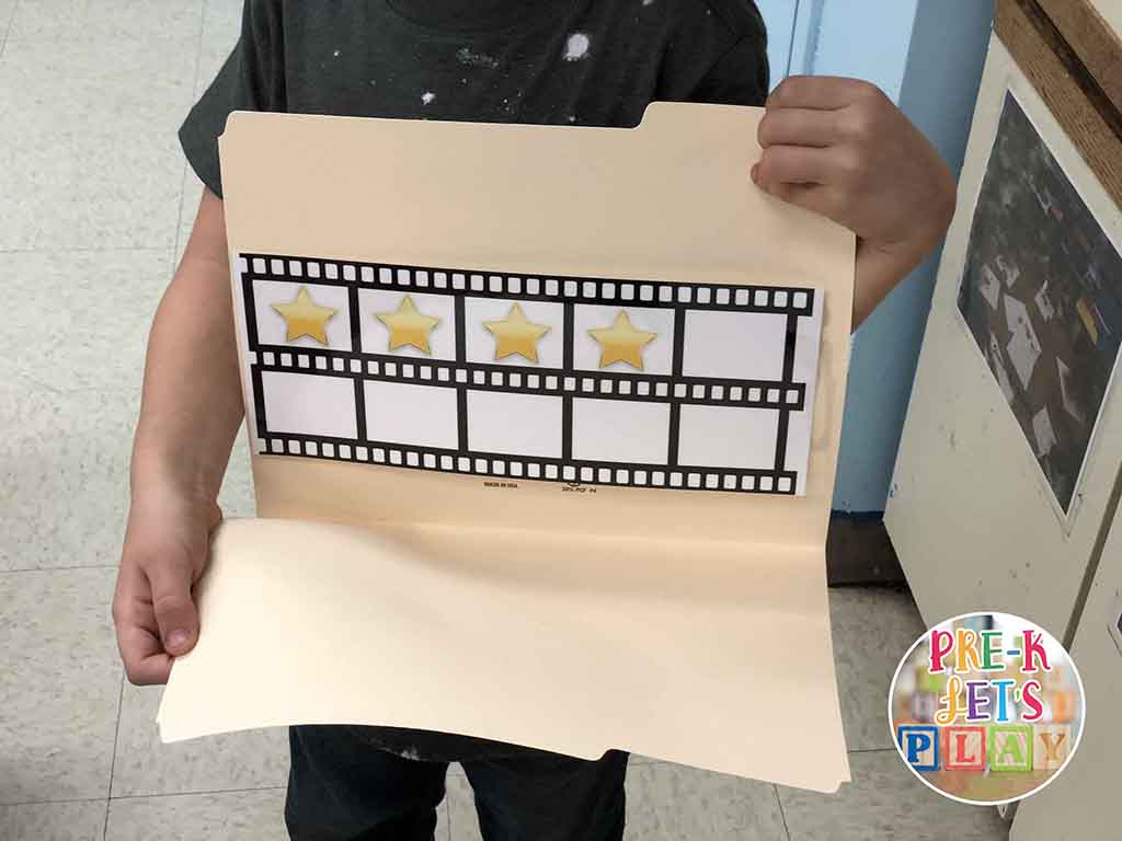 Kid flashing his Snapshot math game. In this educational game, kids have to guess how many stars they can see without counting.