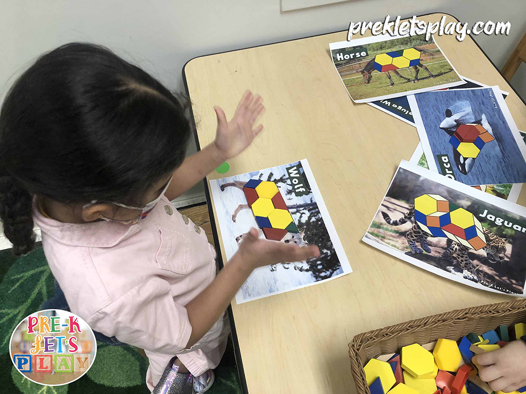 Girl playing math center activities and completing pattern block printables of wolf arctic animal