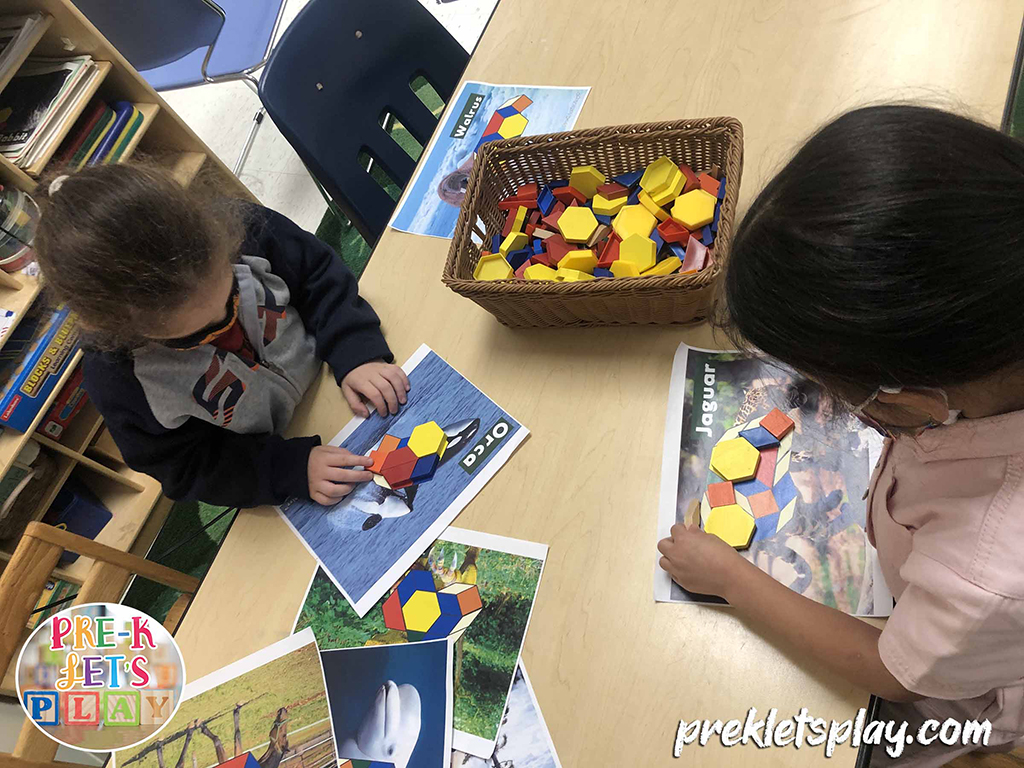 Preschool boy and girl playing pattern block math activities during small group play