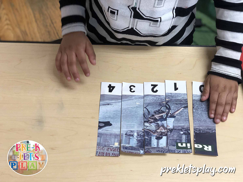 Preschool kid using their problem-solving skills to complete the number order of this rainy weather activity